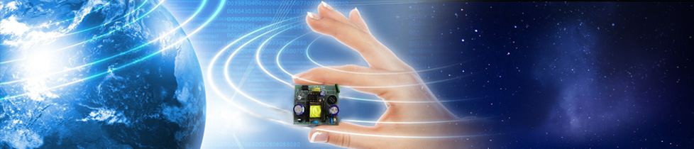 Banner graphic depicting the planet Earth human hand holding electronic circuit against a star-field background